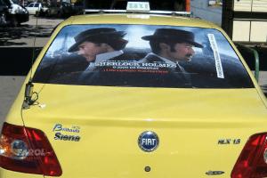 sherlock-holmes-taxidoor-cinema-midiaemtaxi