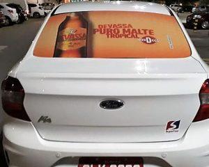 propaganda Cerveja Devassa nos taxidoor na cidade de Maceió