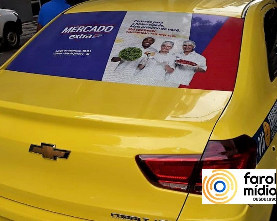 o Extra supermercado anunciou no taxidoor